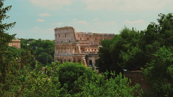 Thumbnail for The Famous Colosseum in Rome. In the Foreground There Are Green Trees. Summer in Rome