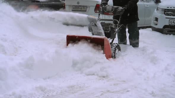 Thumbnail for Man with a Snow Blowing Machine Working