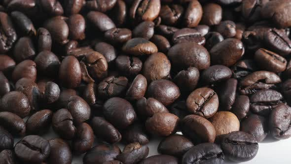 Thumbnail for Pile of roasted coffee beans close-up 4K slow tilt footage