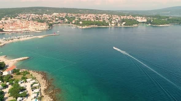 Aerial view of boat arriving at Krk bay during the summer, Croatia.
