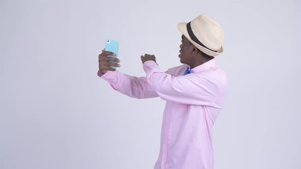 Cover Image for Young Happy African Tourist Man Video Calling with Phone
