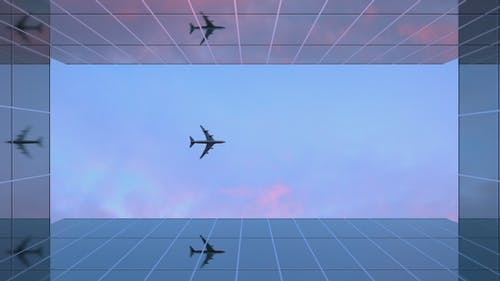 Airplane Over Glass Skyscrapers