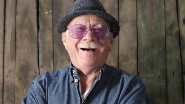 Thumbnail for Happy Stylish Elderly Man Laughing