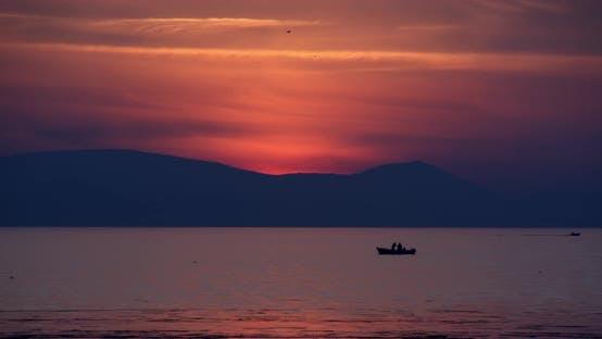 Fishermen On The Sea Sunset