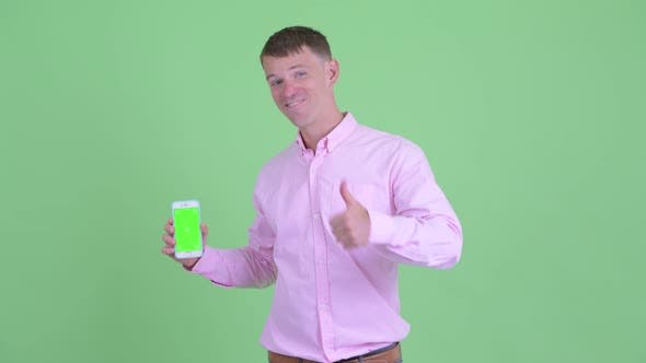 Thumbnail for Happy Businessman Showing Phone and Giving Thumbs Up