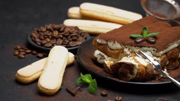 Thumbnail for Portion of Classic Tiramisu Dessert and Savoiardi Cookies on Concrete Background