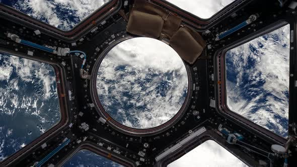 Thumbnail for View From the Porthole of the Space Station on Planet Earth