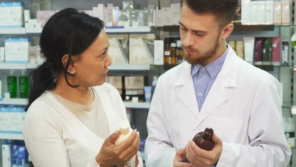 An Adult Woman Consults a Pharmacist About Remedy