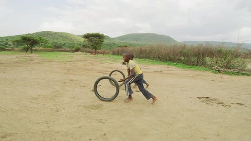 Children playing with wheels