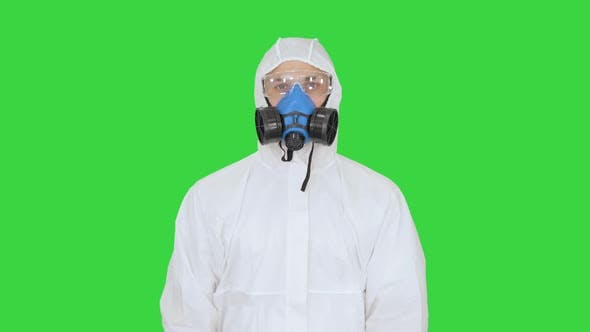Thumbnail for Epidemiologist Showing Stop Sign and Showing Cross with His Hands on a Green Screen, Chroma Key.