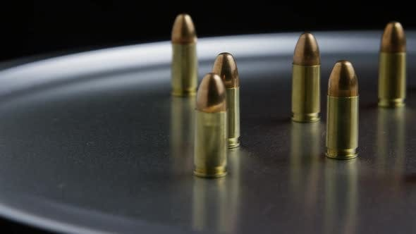 Cinematic rotating shot of bullets on a metallic surface - BULLETS 052