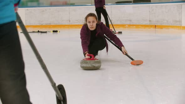 Thumbnail for Curling - a Woman Skating on the Ice Field with a Granite Stone and Releasing It