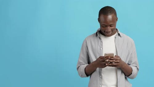 Millennial Black Guy Networking on Cellphone, Empty Space