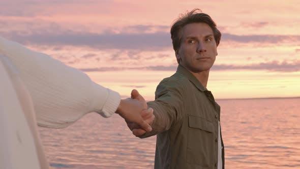 Thumbnail for Happy Man and Woman Walking at Sunset