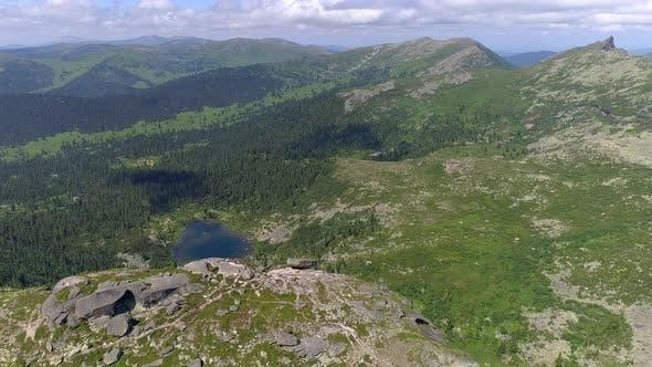 Thumbnail for Flying Over Mountain Landscape