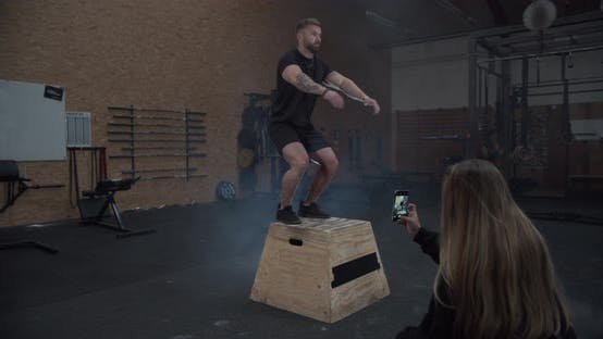 Thumbnail for Sporty Muscular Male Doing the Box Jump While His Girlfriend Taking Photos