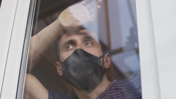 Man in Protective Mask Behind the the Window on Quarantine