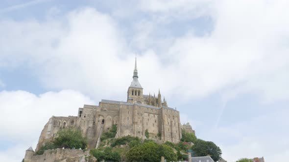Thumbnail for Beautiful Mont Saint Michel  by the day in Normandy France 4K 3840X2160 UHD slow tilt video - Abbey