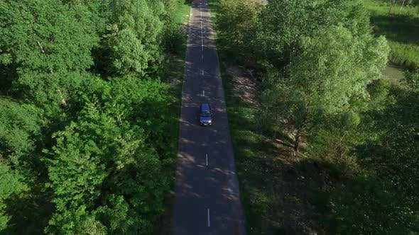Thumbnail for Car Moving on Countryside Road Through Summer Forest Aerial View