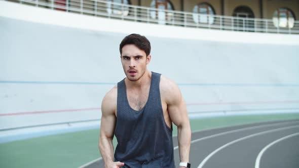 Thumbnail for Male Runner Running at Modern Track. Sport Man Running on Racetrack