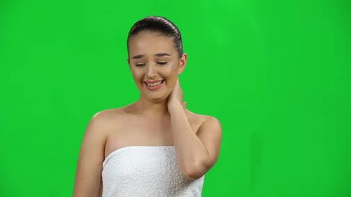 Girl in White Towel Looks Confused, Feeling Guilty Confused Says: Oops Sorry. Green Screen