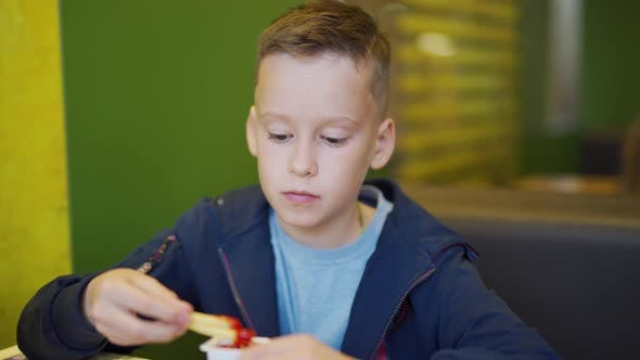 Thumbnail for Boy Eating French Fries