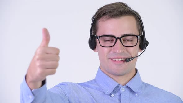 Thumbnail for Young Happy Handsome Businessman As Call Center Representative Giving Thumbs Up