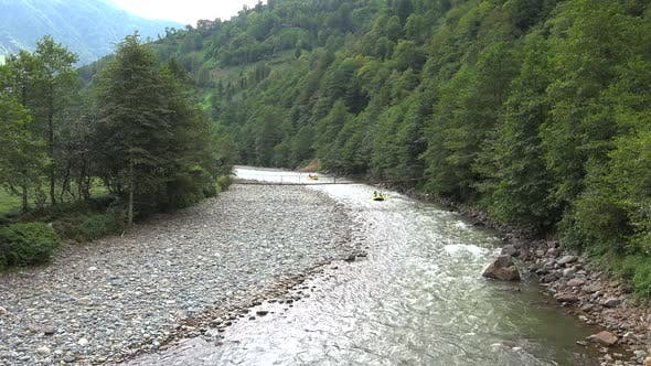 Cover Image for Two Yellow Inflatable Boats Rafting on the River in the Forest
