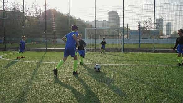 Thumbnail for Two Young Footballers Scoring Goals During Play
