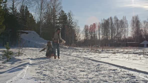 Thumbnail for Woman and Boy Sledding in Winter