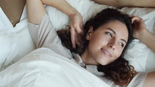 Woman Waking up Smiling in Bed