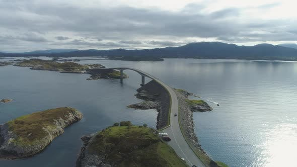 Cover Image for Car Is Going on Atlantic Ocean Road in Norway