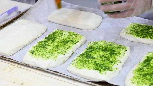 Chef Makes a Pizza and Spreads It with Pesto Sauce