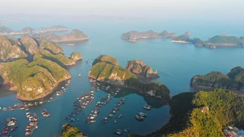 Aerial: sunset clear sky at Cat Ba island and beach with new tourist resort, Halong bay Vietnam
