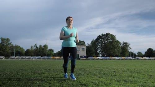 Running. Senior woman jogging