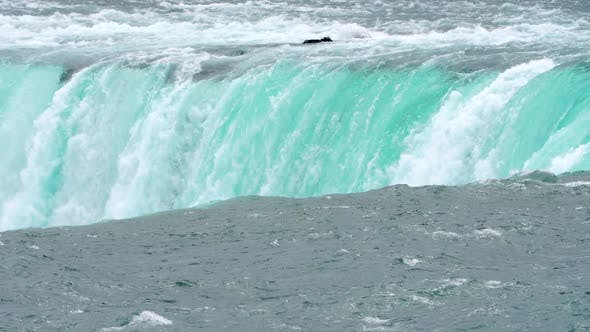 Thumbnail for Close-up View of the Powerful Raging Whitewater Waterfall Falling Forcefully Over a Rocky Edge