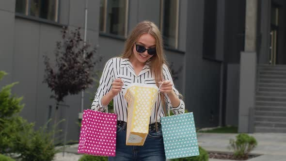 Thumbnail for Teenager Girl in Trendy Clothes with Multicolor Shopping Bags. Black Friday Sale Discounts Concept