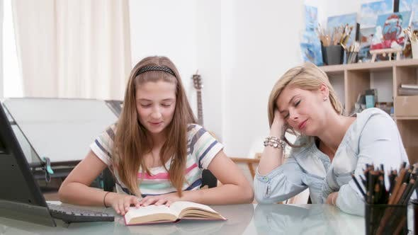 Thumbnail for Teenage Girl Reads a Text To Her Mother As She Listens Carefully