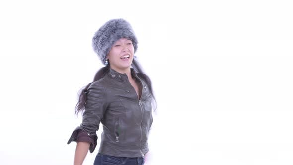 Thumbnail for Happy Beautiful Asian Woman Dancing and Ready for Winter