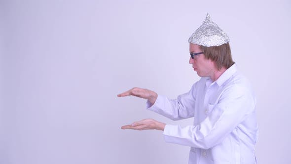 Thumbnail for Young Man Doctor with Tinfoil Hat Shaking While Showing Something