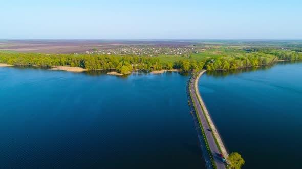 Cover Image for Flying Over the River Dam. Aerial Camera Shot. Ukraine