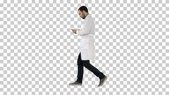 Thumbnail for Male doctor walking and using mobile phone, Alpha Channel
