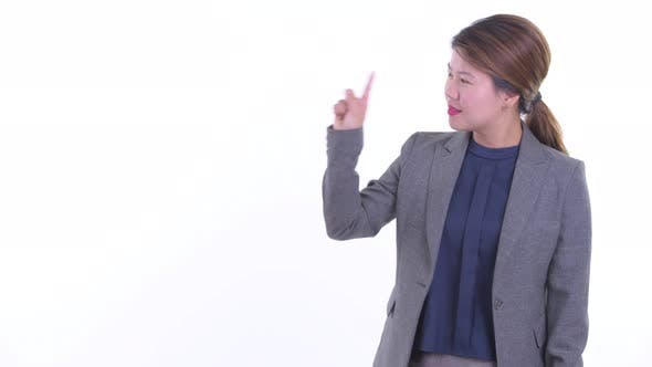 Thumbnail for Happy Young Asian Businesswoman Touching Something and Giving Thumbs Up