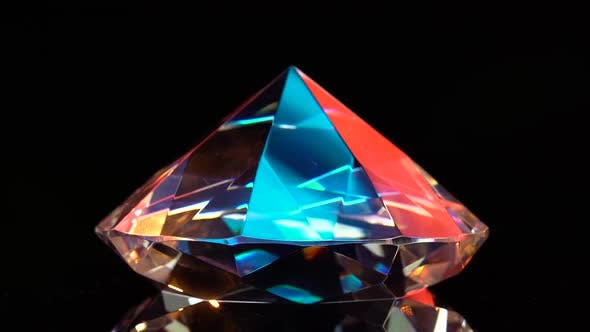 Thumbnail for Diamond Glows with Highlights Because It Is Multifaceted and Transparent. Black Background