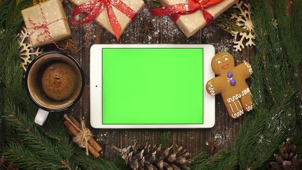 Thumbnail for Look From Above at Tablet with Green Screen Lying Among Christma