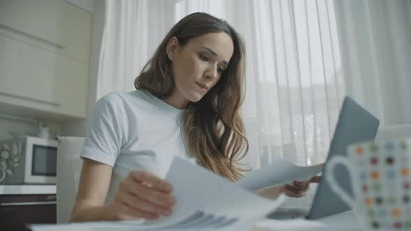 Thumbnail for Thoughtful Woman Working with Documents at Home. Worried Business Woman