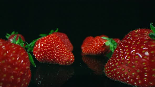 Thumbnail for Isolated Strawberries On Dark Surface