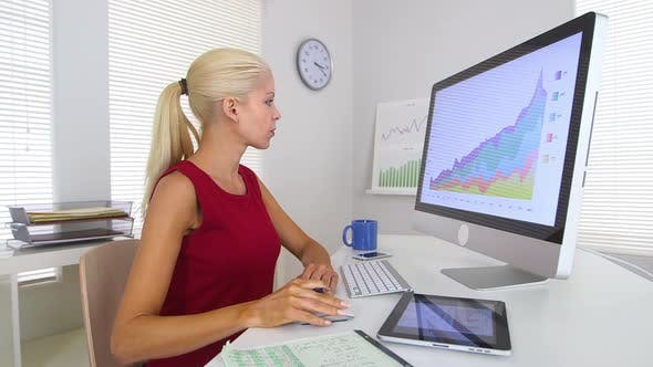 Thumbnail for Business woman using computer and tablet