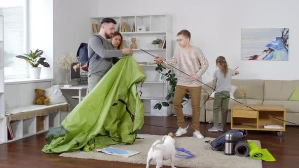 Thumbnail for Family Setting up Tent in Living Room