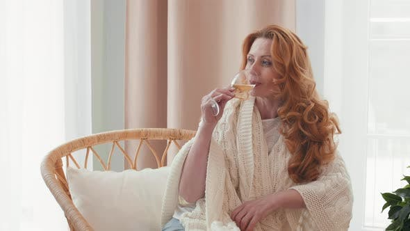 Thumbnail for Aged Beautiful Woman Drinking Wine Indoors